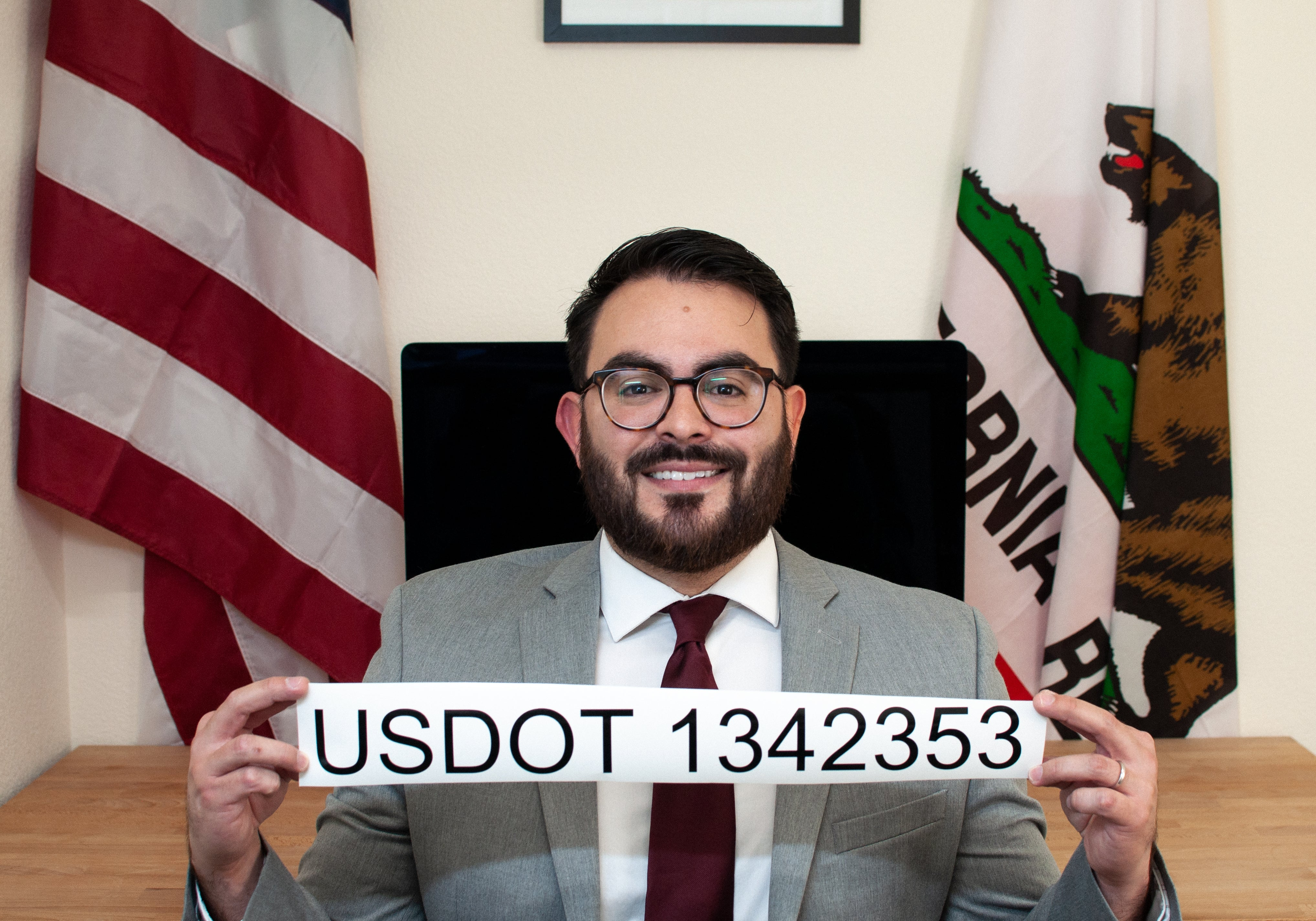 man displaying usdot number decal sticker