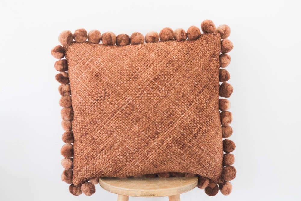 Woven Pom Pom Pillow in Rust