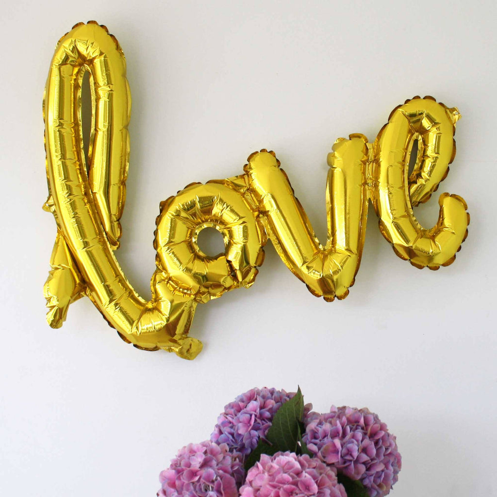 love balloons script in gold hens party