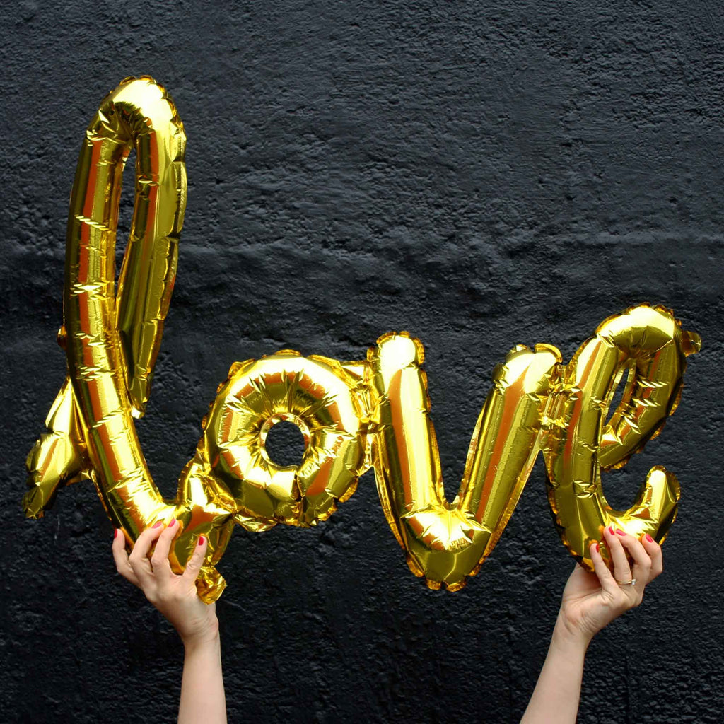 Script love balloons in gold