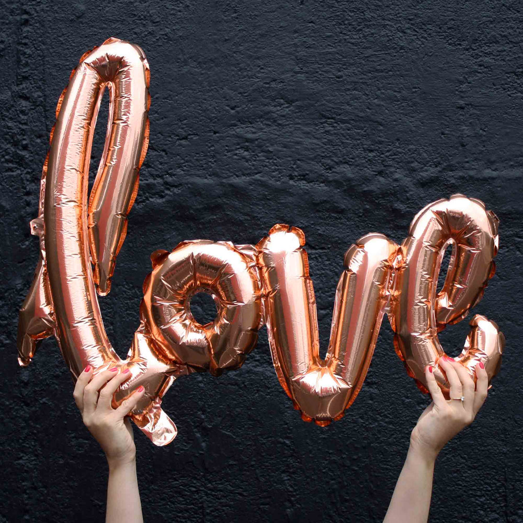 love balloons script in rose gold engagement party