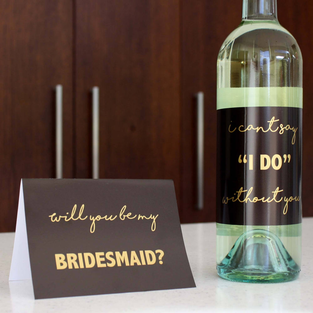 Bridesmaid proposal gold card and wine bottle