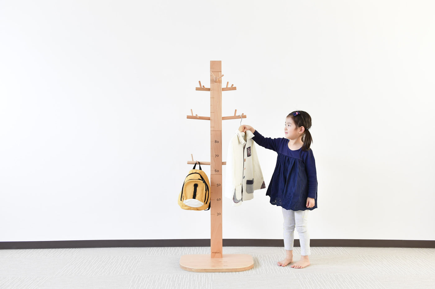 A HEIGHT GAUGE METER OR COAT STAND