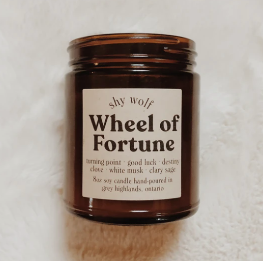 Shy Wolf 'wheel of fortune' candle in an amber glass jar