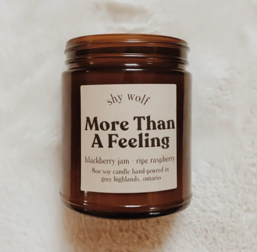 Shy Wolf 'more than a feeling' candle in an amber glass jar