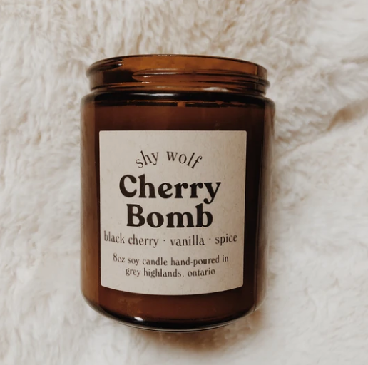 Shy Wolf 'cherry bomb' candle in an amber glass jar