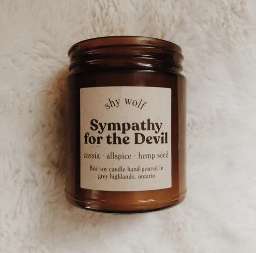 Shy Wolf 'sympathy for the devil' candle in an amber glass jar