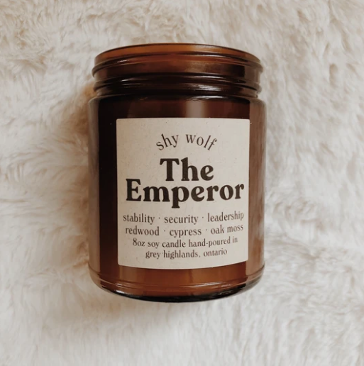 Shy Wolf 'the emperor' candle in an amber glass jar