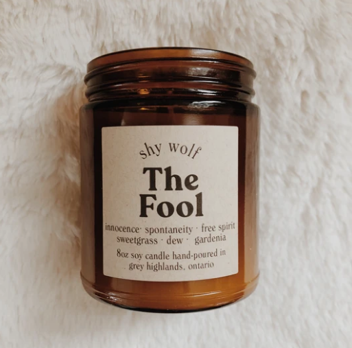 Shy Wolf 'the fool' candle in an amber glass jar