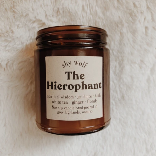Shy Wolf 'the hierophant' candle in an amber glass jar