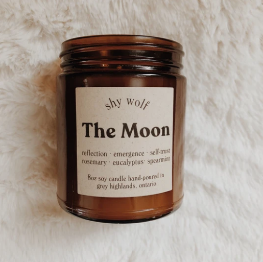 Shy Wolf 'the moon' candle in an amber glass jar
