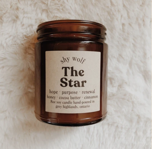 Shy Wolf 'the star' candle in an amber glass jar