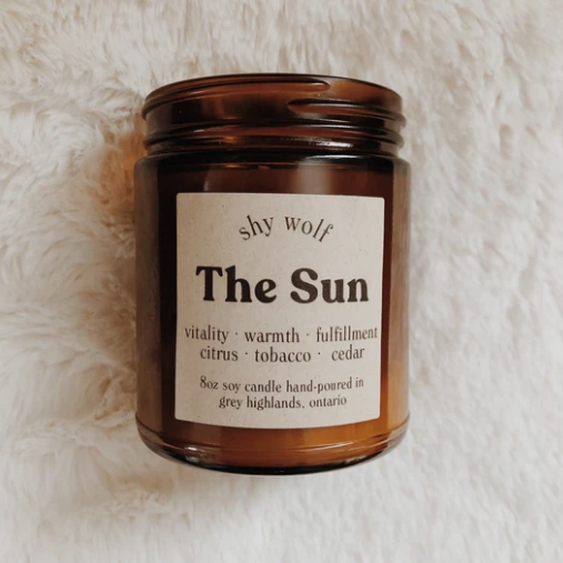 Shy Wolf 'the sun' candle in an amber glass jar