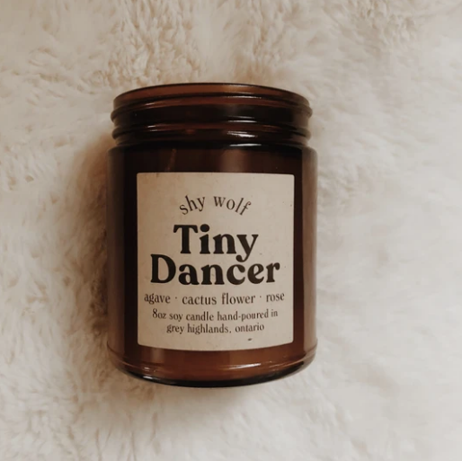 Shy Wolf 'tiny dancer' candle in an amber glass jar
