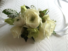 wrist corsage white ranunculus rose by North Shore florist