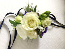 wrist corsage white rose freesia dark blue by North Shore florist