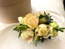 wrist corsage cream roses freesia by North Shore florist