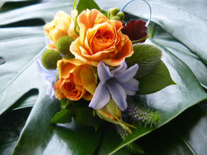 wrist corsage orange blue rose hyacinth by North Shore florist