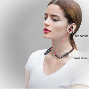 Bluetooth sport ear bud headphones worn on a woman