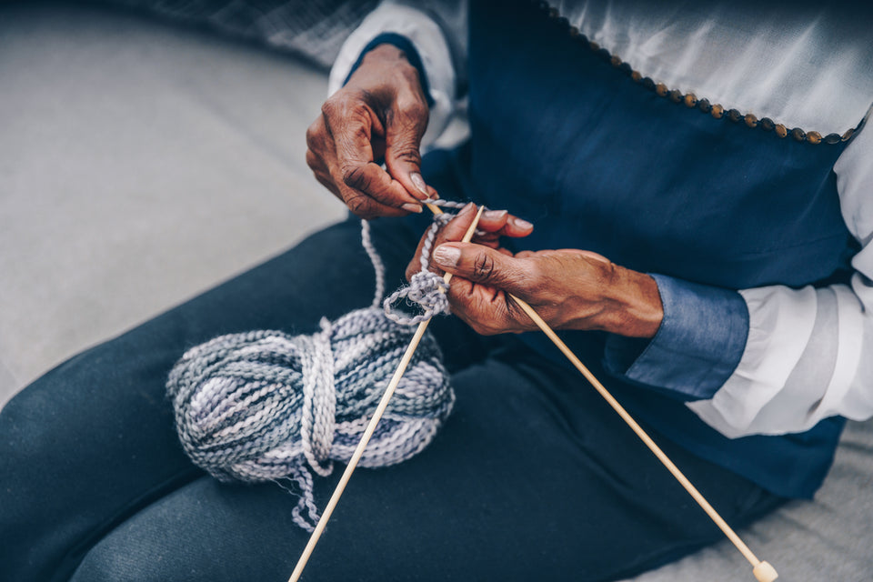 Older woman knitting