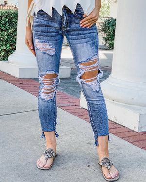 The Parker Distressed Unbalanced Hem Jeans