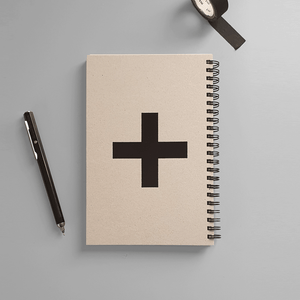 KaRiniTi - Spiral Notebook - Plus Minus- A two-way spiral notebook, so you can write from right to left or left to right. Hardcover in Gray/Black A Plus icon (+) on one side of the cover, and a Minus icon (-) on the other side of the cover.