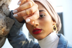 the HOOP earring and the multi earring and ring  by hakthelabel