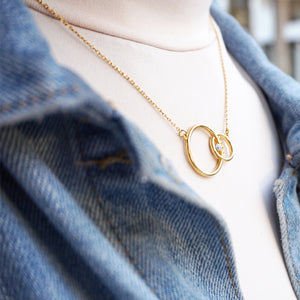 hak the label jewellery evilgem  necklace in gold and diamond. worn by a girl in a denim jacket