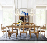 Legacy Rachael Ray Hygge 8 Piece Trestle Dining Room Set w/Upholstered Chairs in Cashmere