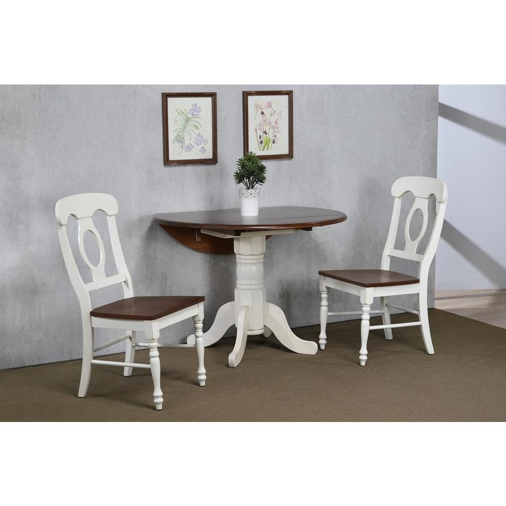 Sunset Trading 3 Piece 42 Inch Round Drop Leaf Dining Table Set inChestnut  w/Napoleon Chairs in Antique White w/Distressed Chestnut Top