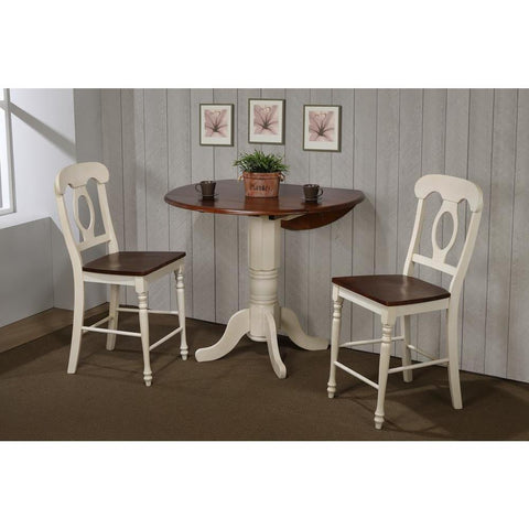 Sunset Trading 3 Piece Andrews 42 Inch Round Drop Leaf Pub Table Set w/Napoleon Stools in Distressed Antique White w/Chestnut