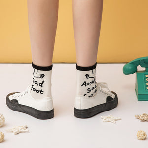 Words printed sad crew socks