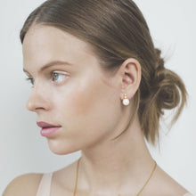 Polar jewelry star pearl earring tarot amethyst white peridot lavender light green collection gift jewellery gold silver mystical love present for women best jewelry brand denmark scandinavian minimal playful diamond necklace bracelet gold chain gemstones jewelers pearl wedding engagement promise charm cz stores pendant moon stars sun organic waves fashion copenhagen