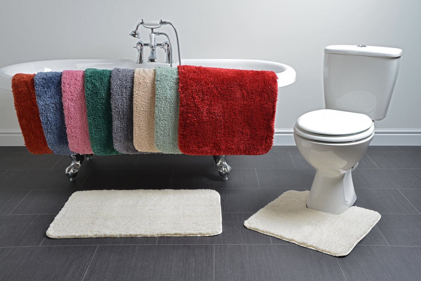 microfibre bath mats on the side of a bath