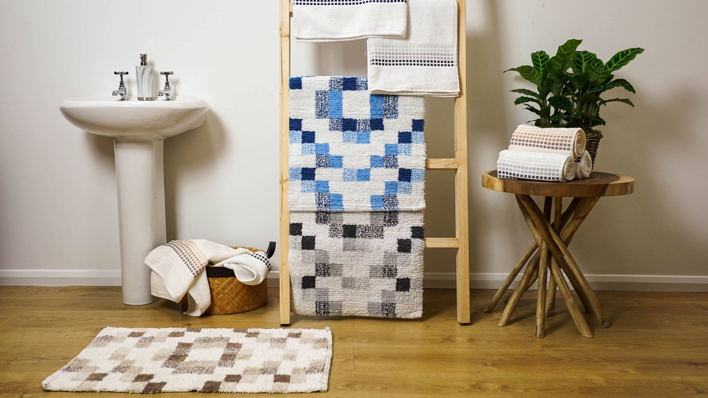 mosaic tile bath mats in blue, grey and natural