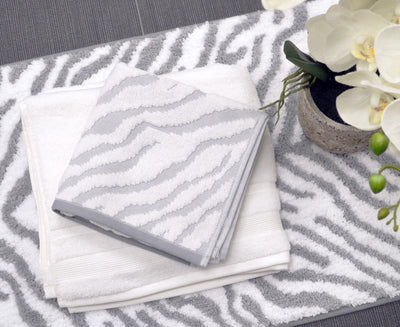 Zebra Towels in Luxury Cotton - hand towels laid on a bath mat
