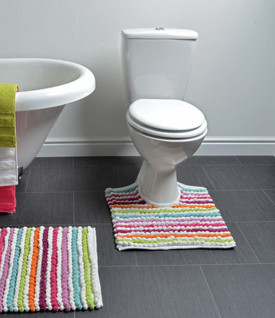 multi coloured california stripe pedestal mat at base of toilet