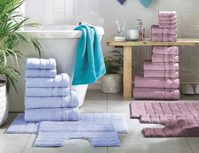 stacks of Egyptian Cotton towel bales in a modern bathroom