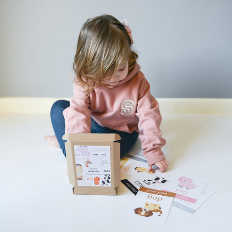 Child playing with flashcards from Little Boo Learning