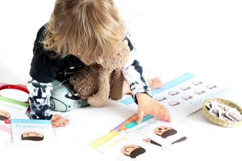Lewis using his emotions flashcards and learning mats from Little Boo Learning | Educational resources for toddlers