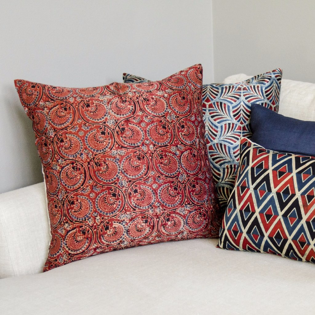 Red and blue hand printed  pillow with exposed metal zip closure