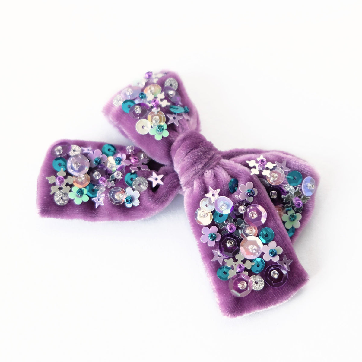 Purple heather colored velvet hair bow embellished with sequin.