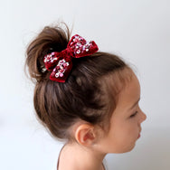 model with velvet hair bow in dark red