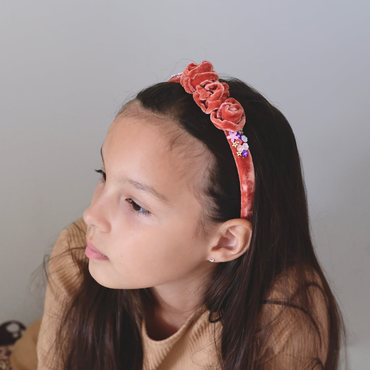 Model with velvet sequin headband.