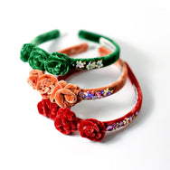 Red, green and copper tone velvet headband embellished with rose buds.
