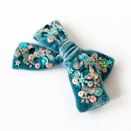 Silver spruce colored velvet hair bow with sequin.