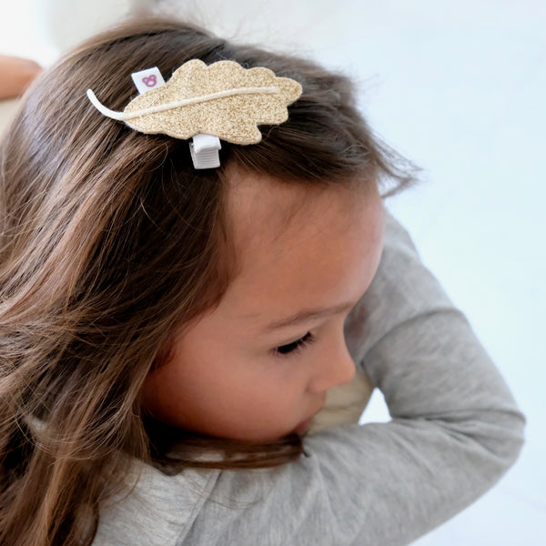 Girl Wearing Gold Oak Leaf Hair Clip