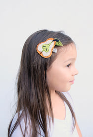 Girl with pear hair clip.