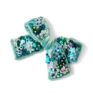 Velvet hair bow with sequin in green color.