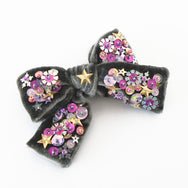 Dark grey velvet hair bow with sequin.